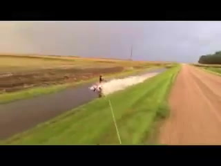 Carter Mosher water skiing in a ditch near Beltrami, Minn.