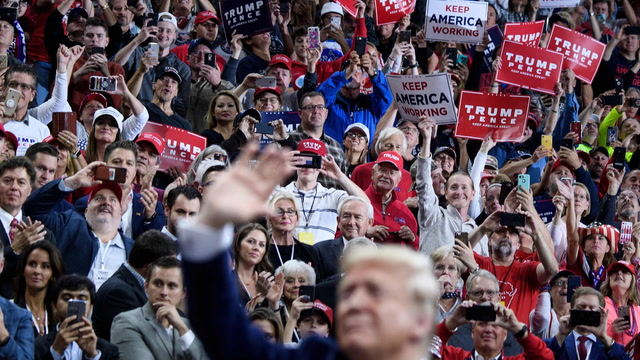 'Let him do his job': Trump supporters shrug off impeachment at Minnesota rally