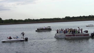 MHS marching band performs as part of annual Boat Parade on Lake Mitchell