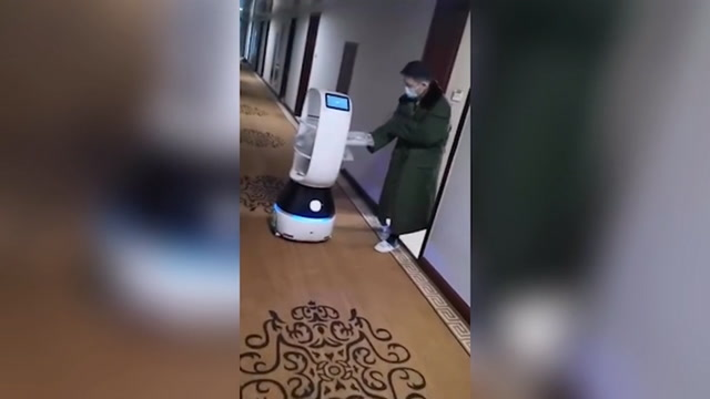 Robots deliver food to people in coronavirus quarantine