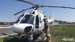Students peek inside U.S. Customs and Border Protection helicopter