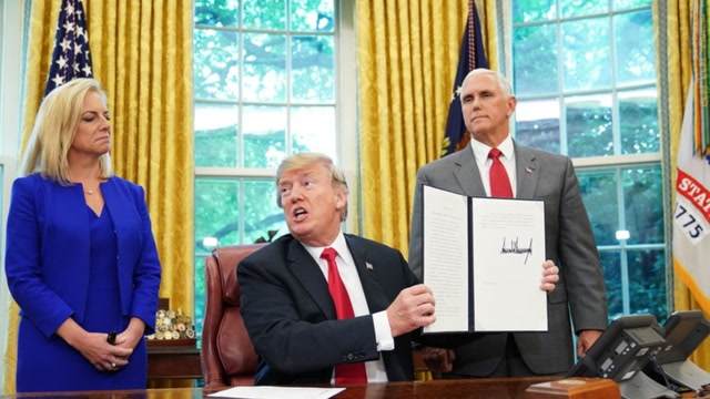 Trump signs executive order ending family separations at the border