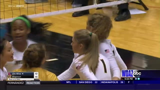 South's Stroup faces off with North's Larson in SEC volleyball match
