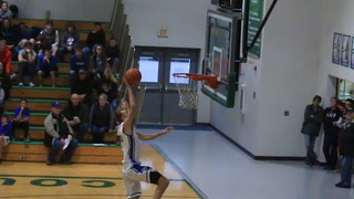 Sioux Falls Christian's Dejay Fykstra dunk off the backboard
