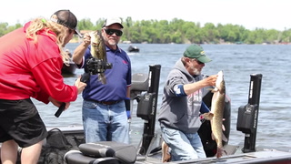 Jim Kalkofen (left) and Al Lindner hold up a couple of walleye they caught Saturday, June 1, during the Minnesota Fishing Challenge on Gull Lake. Kelly Humphrey / Brainerd Dispatch