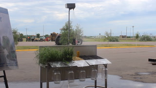Rainfall simulator demonstrates absorption differences between grass and cover crops