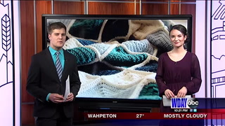 Woman crochets for homeless