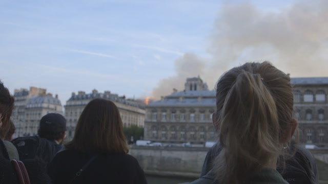 'It feels like a nightmare': Parisians and tourists react to the Notre Dame fire