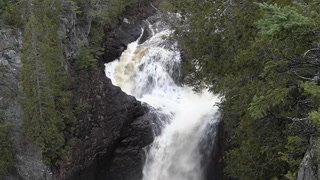 "Devil's Kettle Falls is located along the Brule River at Judge C.R. Magney State Park, near Hovland on Minnesota's North Shore. Researchers are working to figure out where the water that falls into the ""kettle"" (at left) re-emerges. Minnesota DNR file photo"