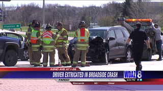 UPDATE: Driver extricated, injuries reported in two-vehicle crash in South Fargo