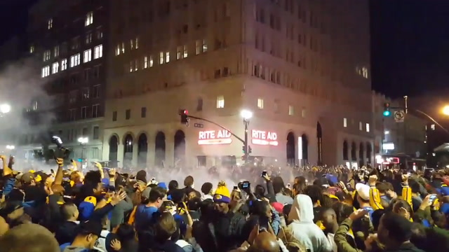 Fans set off fireworks in the streets to celebrate Warriors win