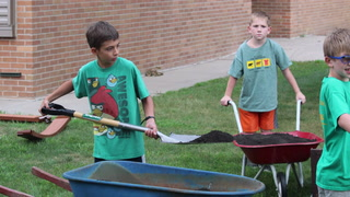 Farmington Cub Scouts help build learning gardens at Farmington Elementary