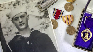 Dante Tini of Virginia a radioman on the USS Oklahoma perished during the attack at Pearl Harbor on Dec.7, 1941. Tini's remains have been identified and are going to be returned to his family this spring. He is pictured with his harmonica and service medals. Clint Austin / caustin@duluthnews.com