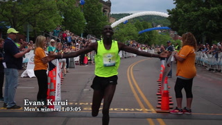 Evans Kurui celebrates at the finish line of the Garry Bjorklund Half Marathon on Saturday morning in Duluth. Kurui won the race with a time of 1:03:05 Clint Austin / caustin@duluthnews.com