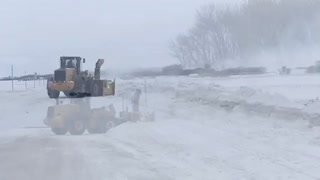 County using blowers to remove snow