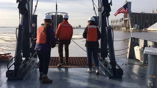 UMD students Allie Rodgers (left) and Nora Curtis help marine technician Wally Lingwall (center, mostly hidden) bring water sampling instruments onboard the Large Lakes Observatory's research vessel Blue Heron. The students were among a group of undergraduates from Swenson College of Science & Engineering instructor Angela Sharp's math class learning how math can apply to real world research. (Steve Kuchera / Forum News Service)