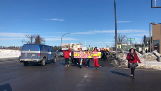 A woman walks south on Paul Bunyan Drive in the second Missing and Murdered Indigenous Women's Walk Wednesday in Bemidji. Marchers walked from the Northwest Indian Community Development Center to BSU's Beaux Arts Ballroom. (Jillian Gandsey | Bemidji Pioneer)