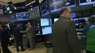 Wall Street dips on Trump protectionism