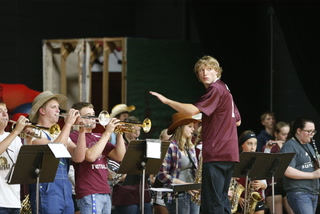 Students conduct pep band at WCA game