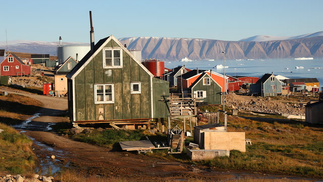 After being displaced from their native village, a Greenlandic Inugguit community faces a new threat: climate change
