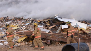 A fire in the demolition pile at the Kandiyohi County landfill continued to burn below the surface after the flames were downed early Sunday morning. The landfill is about 12 miles north of Willmar.