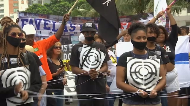 Protesters march against police killings in Brazil