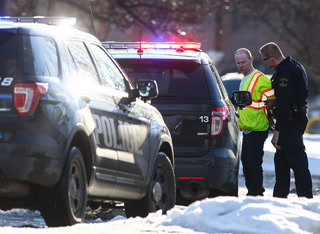 One of the suspects in the car was taken into custody without injury after a robbery at Discontent in Grand Forks on Friday, February 17, 2017. (Joshua Komer / Grand Forks Herald)