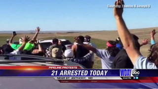 21 protesters arrested, one protestor's cellphone captured confrontation
