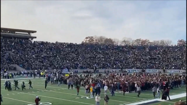 Student protesters storm the field before Harvard-Yale game