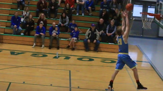 Chester Area's Levi DeVries dunk off the backboard