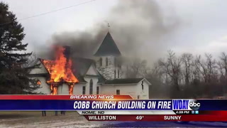 The former church in Nome, N.D., purchased by white supremacist Craig Cobb was on fire Wednesday, March 22. Special to The Forum