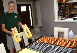 Jeff Sprecher of Grand Forks shows off some of the Airhead muskie lures he developed and is marketing with assistance from KMDA Inc., a Bovey, Minn., distributor and manufacturer. Airheads are available in three colors, but Sprecher has experimented with other colors when pouring the soft plastic components in his Grand Forks home. Brad Dokken / Forum News Service