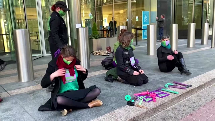 Climate activists smash windows at Barclays' London HQ