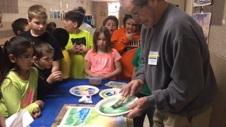 Jim Mondloch paints with MAES students