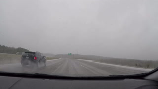 Time-lapse morning commute in spring sleet, freezing rain