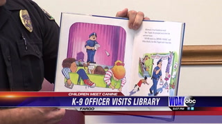 K-9 officer visits children at library