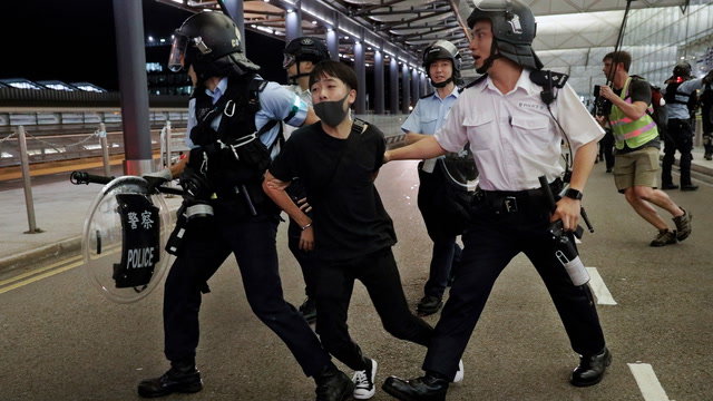 A chaotic day in Hong Kong ends with specter of more violence to come