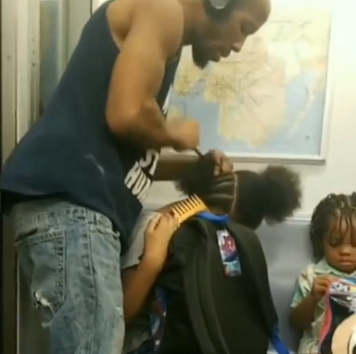 Black Dad Goes Viral Braiding Daughter's Hair During NYC Subway Ride