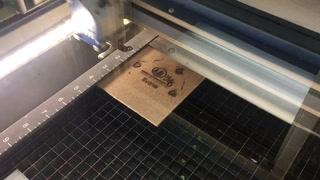 Laser etching wooden cookies at BSU