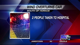 Wind gusts cause car to overturn on highway