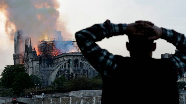 'It feels like a nightmare': Parisians and tourists react to Notre Dame fire
