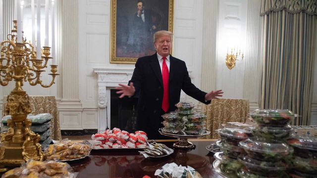 'Great American food': Watch Trump welcome the Clemson Tigers with a fast-food buffet