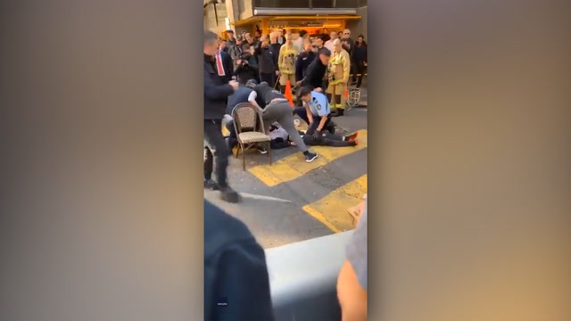 Video shows bystanders in Sydney subduing stabbing suspect with crate