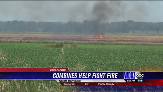 Combines help fight field fire near Downer