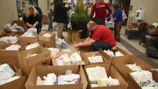 MTI students prepare 440 packs for the Mitchell Snack Pack program