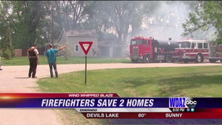Firefighters save two homes