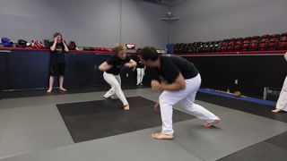 Duluth martial arts students practice capoeira