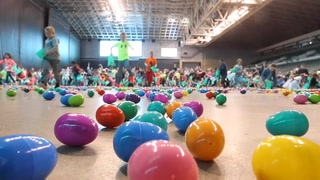 Children make a dash for Easter eggs at the annual Easter Egg Scramble at the Alerus Center Saturday. About 15,000 eggs,  filled with candy or slips of paper redeemable for prizes, awaited hundreds of kids ages 2-8 at the annual event. The Alerus Center and Cities FM 104.3 were sponsors.  photo by Eric Hylden/Grand Forks Herald