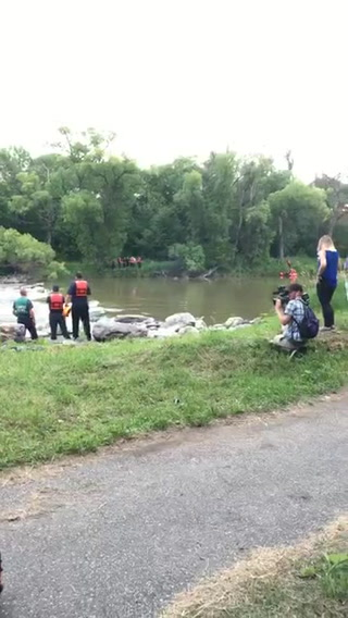 Crews working to rescue two from Red River in Fargo