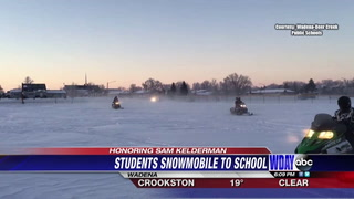 Wadena High School students ride snowmobiles to honor student